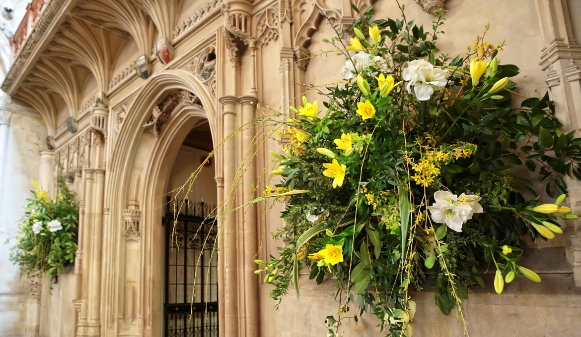 A picture of flower arrangements under the organ screen