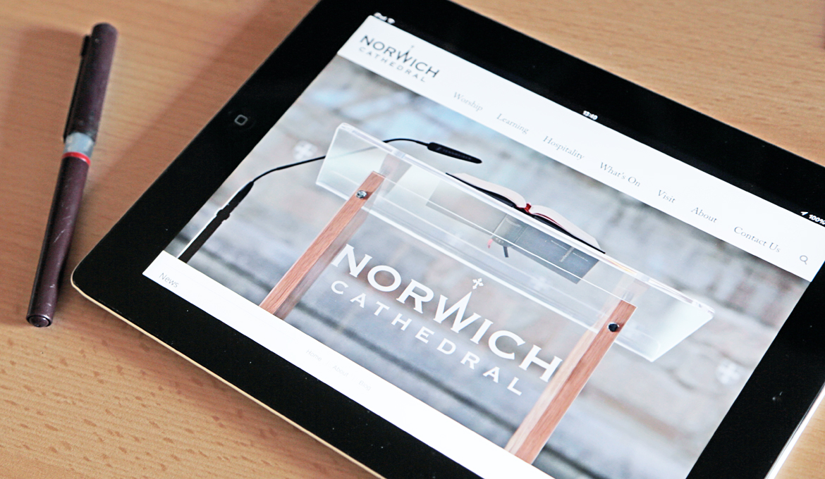 A picture of an ipad with the Cathedral website open