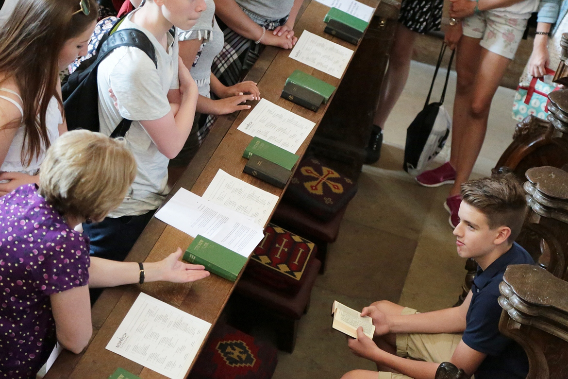A picture of a school group sitting in the choir stalls