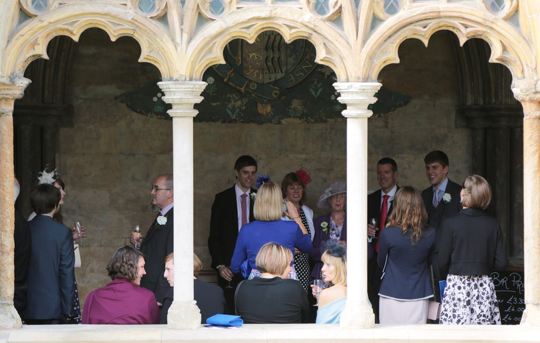 A picture of wedding guests in the cloisters