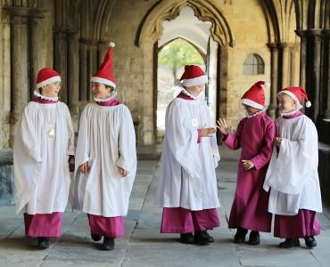 A picture of Choristers wearing Santa hats