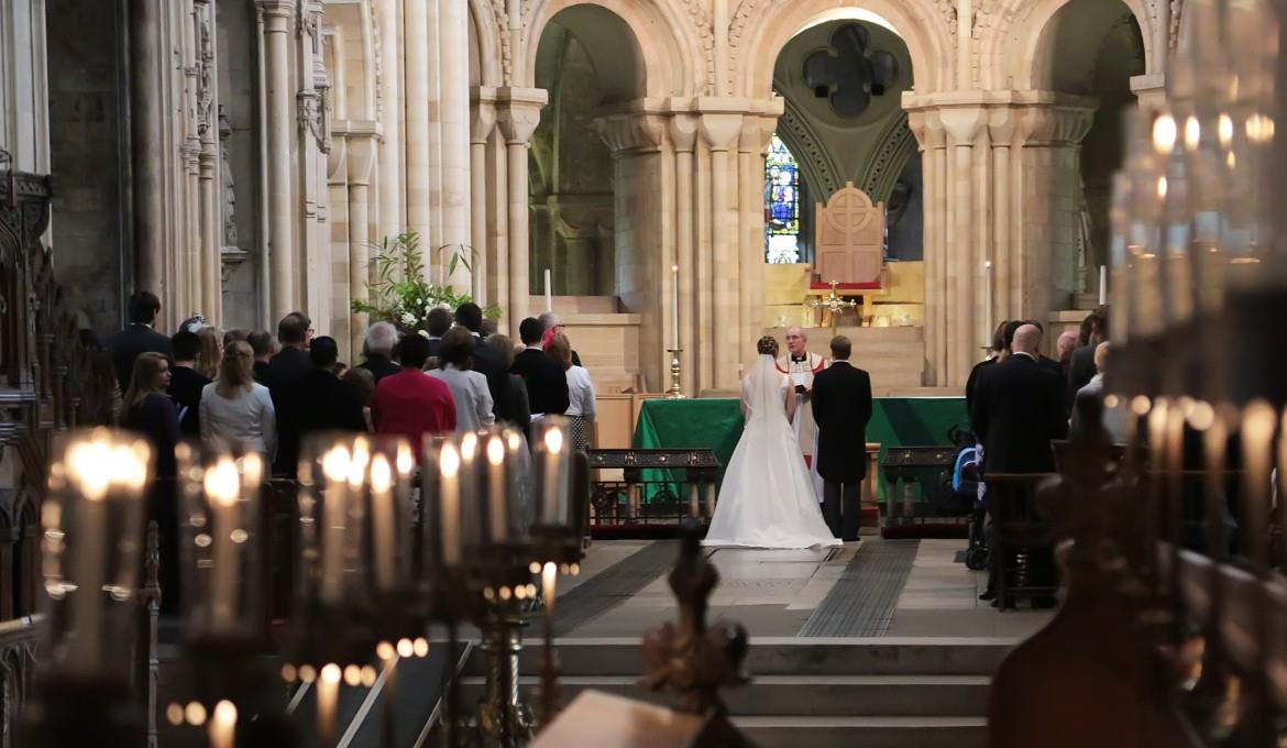 A picture of a wedding ceremony at the high altar
